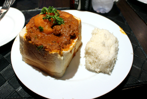 "Indulging on a piece of ""bunny chow"""