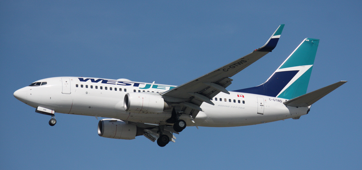 WestJet introduces fee for first checked bag on some flights
