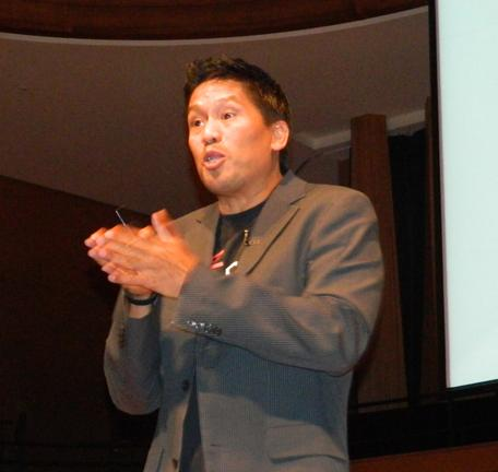 G Adverntures founder Bruce Poon Tip addresses the audience at the 2014 Future of Tourism event