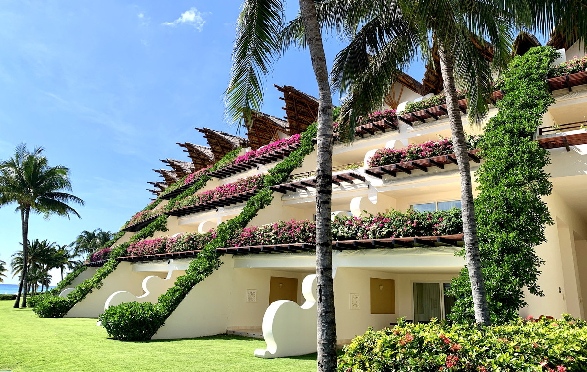 GARDENS GALORE. Flower-filled balconies grave the oceanfront Ambassador section at Grand Velas Riviera Maya.