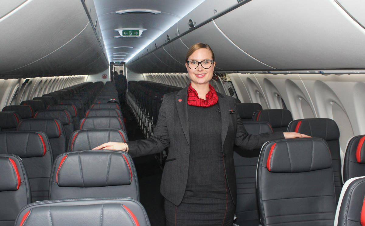 WELCOME ABOARD. Air Canada flight attendant Daphnee welcomes guests on board the new A220-300.