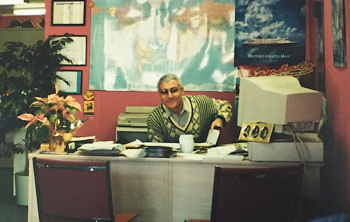 BACK IN THE DAY. Company founder Patrick Luciani at his desk in the early days of Luciani World Travel. Photo courtesy of the Luciani family.