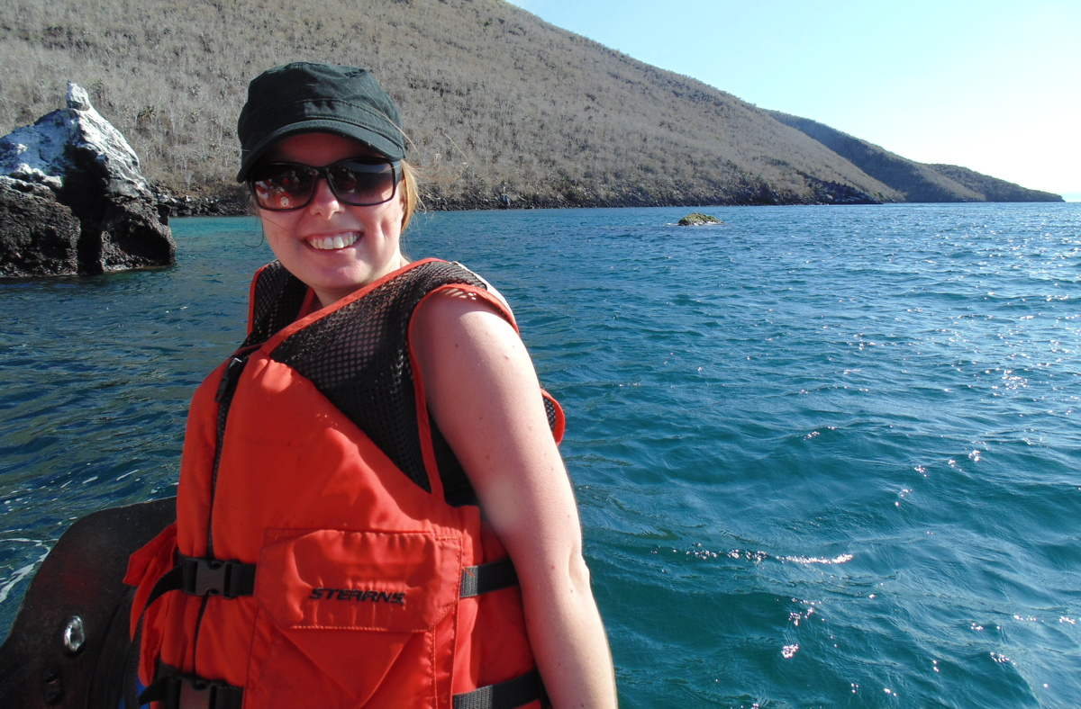 """I could never go back to a desk!"" says Erz, seen here in the Galápagos Islands. Photo courtesy of Kristin Erz."