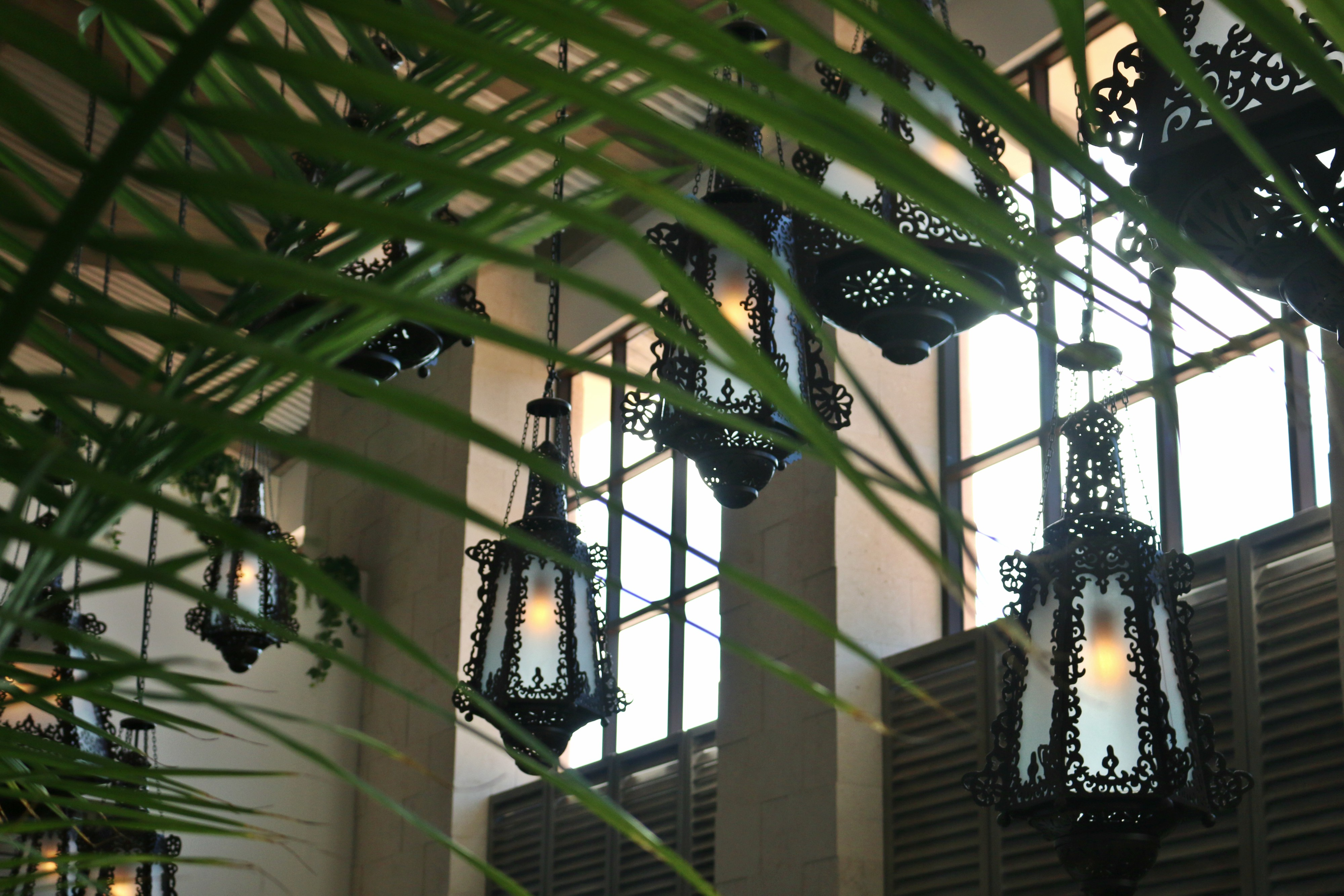 Giant wrought-iron lanterns hang haphazardly in the lobby, creating a warm and relaxing atmosphere.