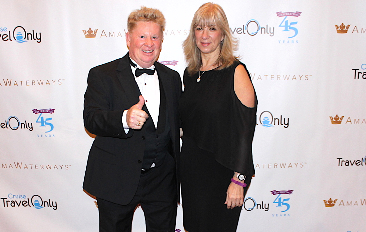 THUMBS UP. TravelOnly advisors Pat Probert and Mary de Almeida celebrate TravelOnly's 45th at Caesars Palace in Las Vegas.