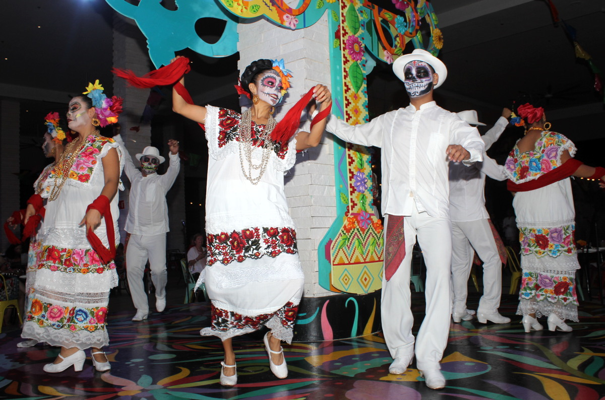 "DANCE YOURSELF TO DEATH. Palace Resort's ""Flavours of Mexico"" party at The Grand at Moon Palace landed on Mexico's Day of the Dead holiday."