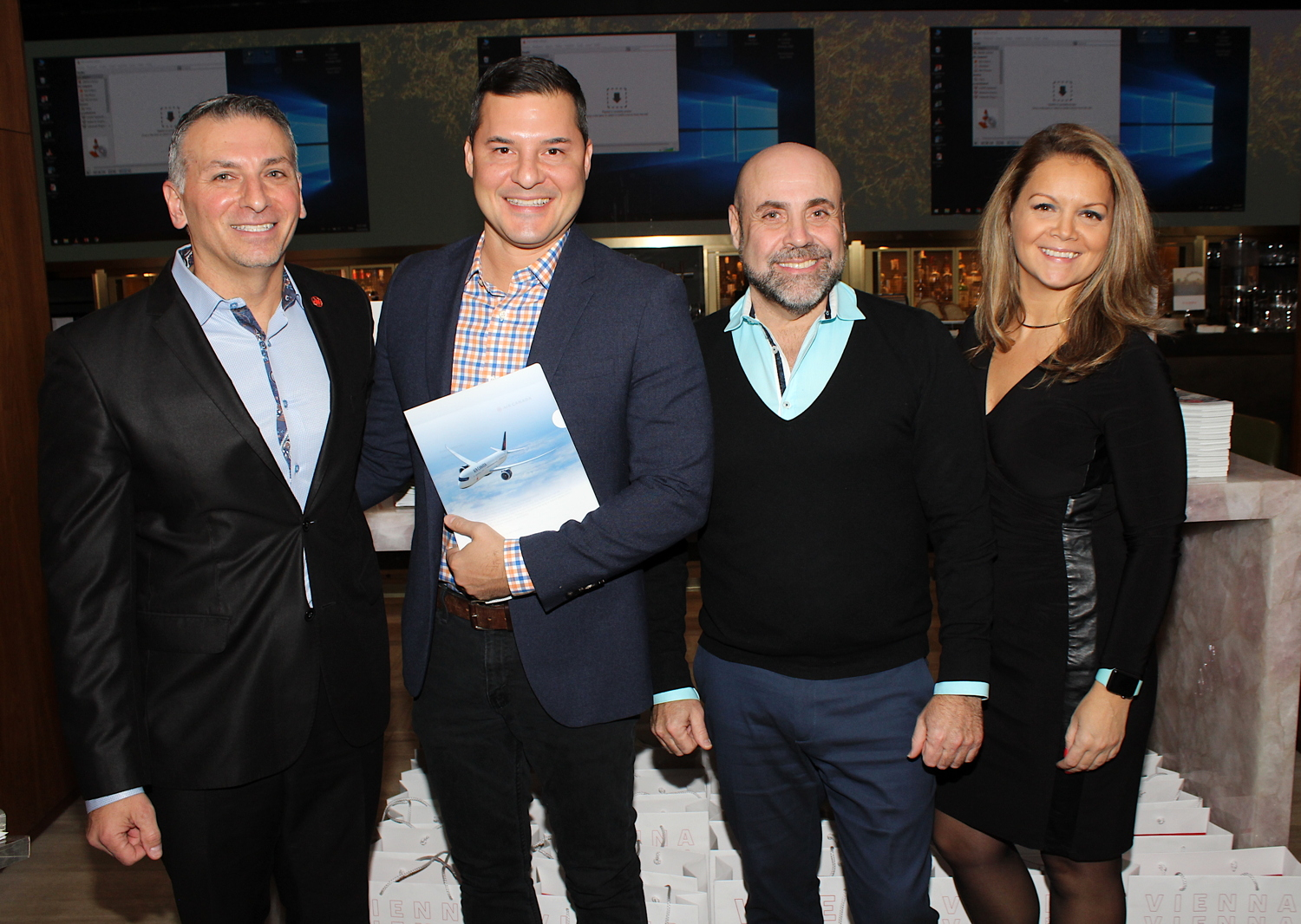 From left: ACV's Nino Montagnese, attendee Ryan Lester, AMPM's Armando Mendonca and Air Canada's Simona Cercel. Lester won the morning's big draw prize: round-trip airfare for two to Vienna courtesy of Air Canada.