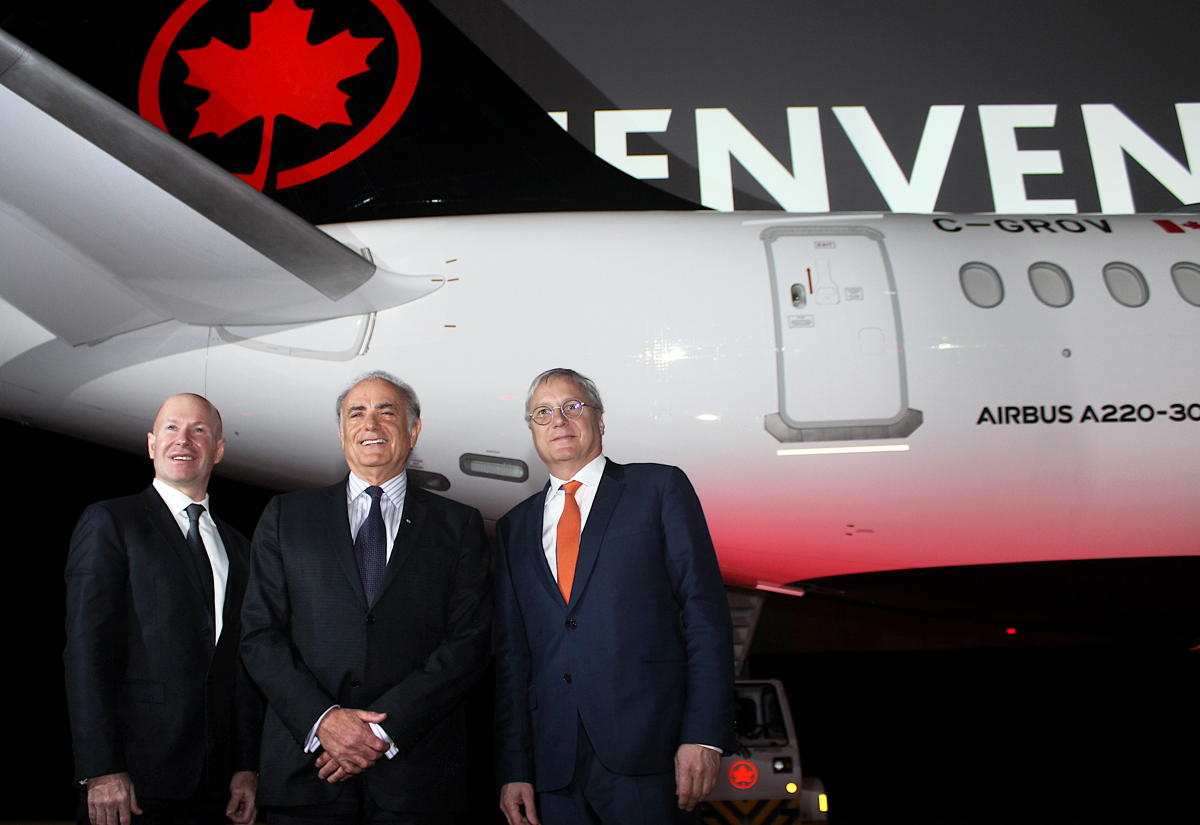 From left: Alain Bellemare, President & CEO, Bombardier; Calin Rovinescu, President & CEO, Air Canada; and Christian Scherer, CCO & Head of International, Airbus, at the unveiling of Air Canada's A220-300 in Montreal.
