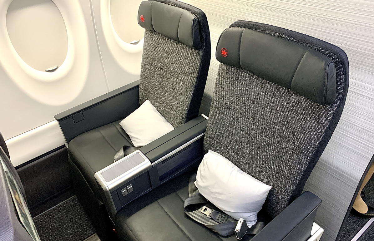 THIS MEANS BUSINESS. All Business Class seats are window or aisle, with access to a footrest and storage console.