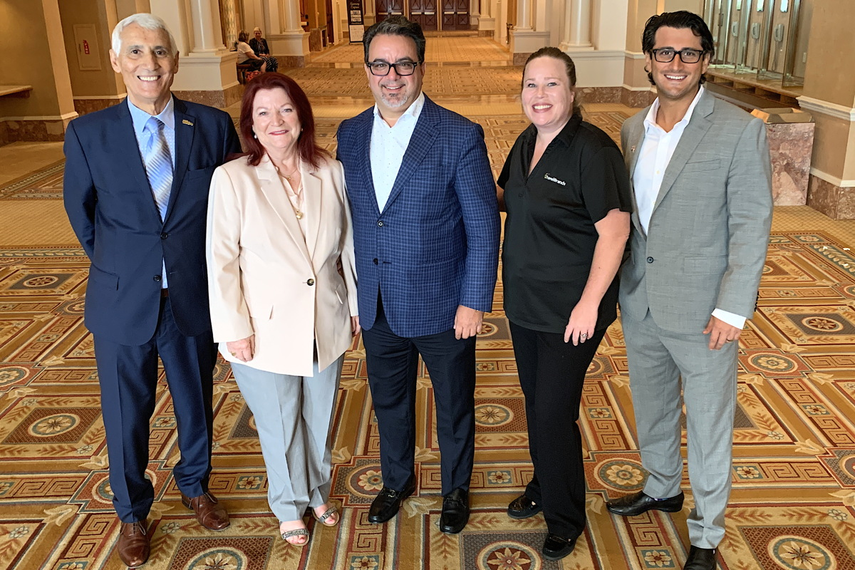 PARTNERSHIP. From left: TravelOnly's Patrick & Ann Luciani; TravelBrands' Frank DeMarinis & Shannon Smith; TravelOnly's Gregory Luciani.