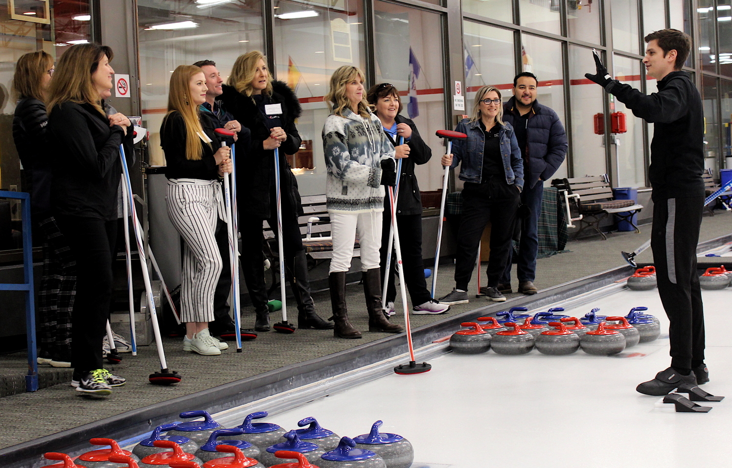 SWEEPING SUCCESS. TravelOnly's preferred partners grabbed their brooms and hit the ice in a friendly curling match at Toronto's Granite Club.