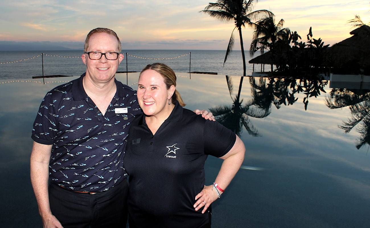 ON LOCATION. Transat's Robert Reed (left) & Susan Kooiman check out the infinity pool at the brand new Armony Luxury Resort & Suites.