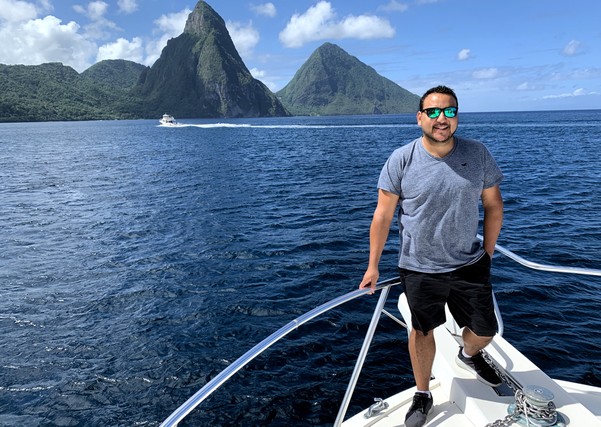 """Going out & immersing yourself into the culture and with the people is our richest asset,"" said Rod Hanna, seen here in front of St. Lucia's famous Pitons."