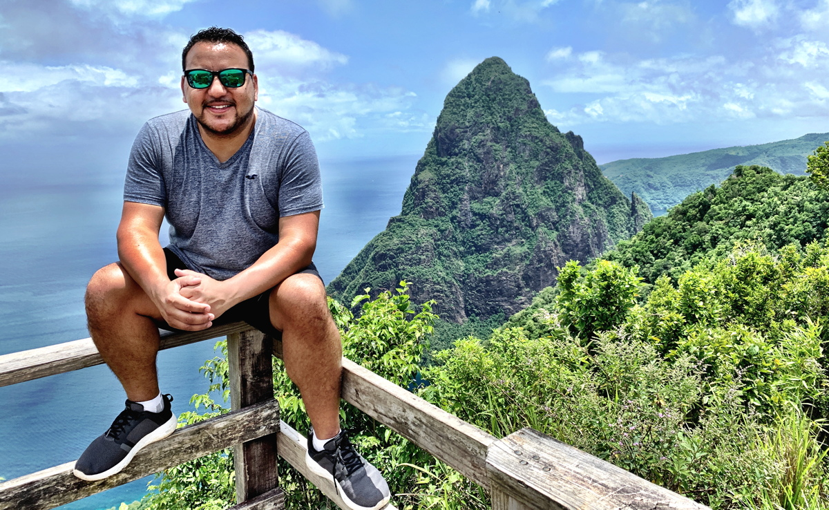 Rod Hanna of The Saint Lucia Tourism Authority finds a sweet view of The Pitons while hiking the Tet Paul Nature Trail in Saint Lucia.