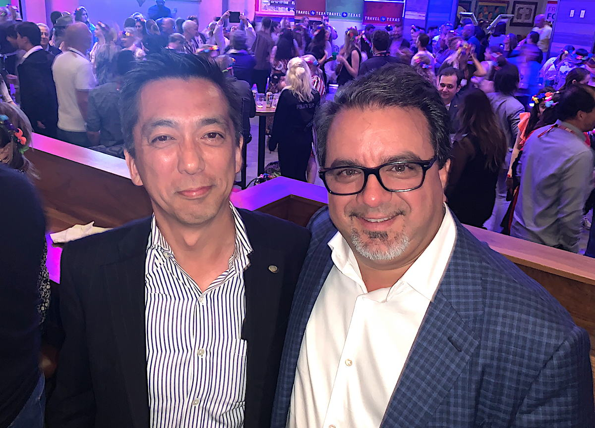From left: Hideo Hatano, president and CEO of H.I.S. Co., Ltd.; Frank DeMarinis president and CEO of TravelBrands.