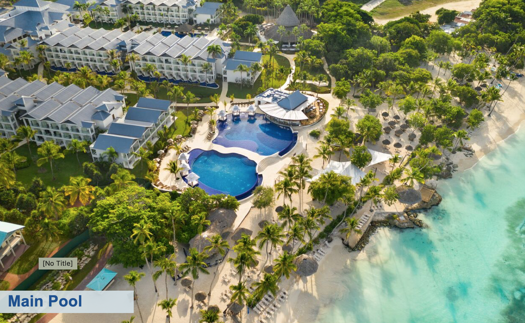 DIVE IN. A birds-eye view of the main pool at Hilton La Romana Adults Only. Photo: Playa Hotels and Resorts