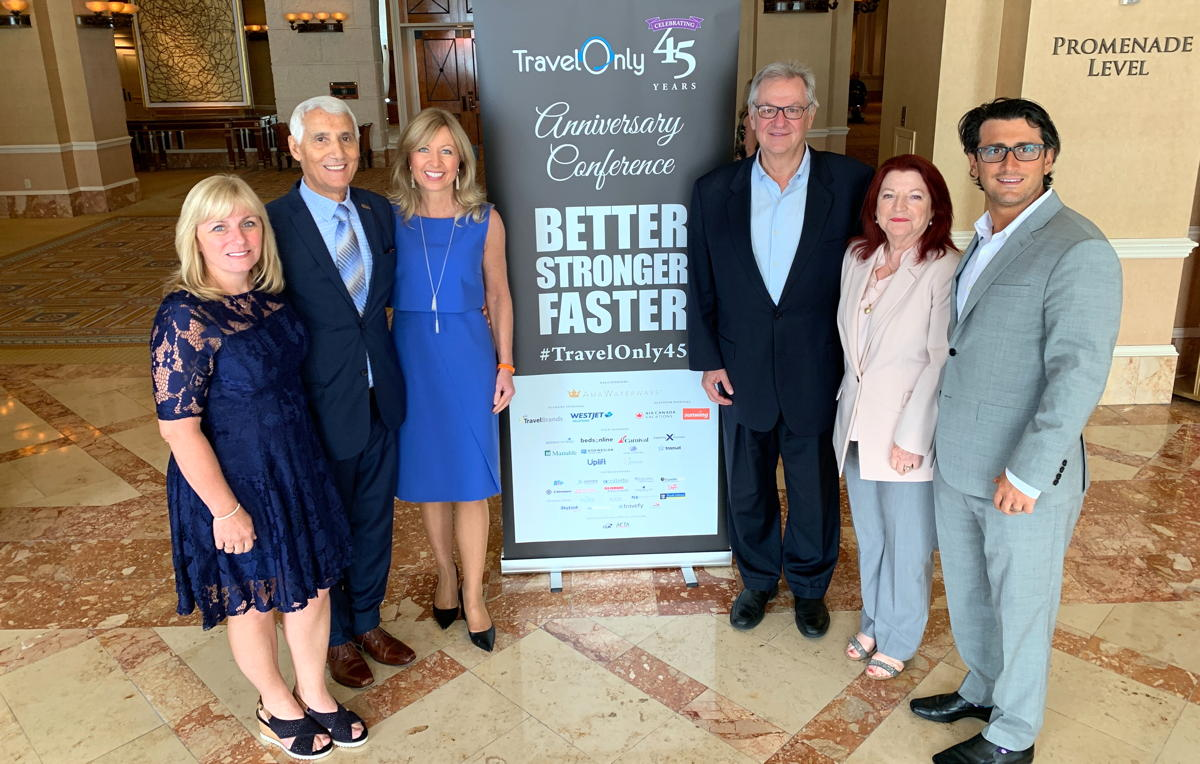 From left: Sandra Gardiner, Patrick Luciani, Kristin Karst, Rudi Schreiner, Ann and Gregory Luciani in Las Vegas last September. (Pax Global Media)