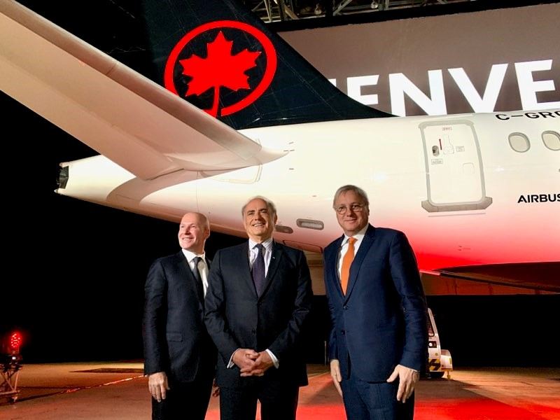 From left: Alain Bellemare, President & CEO, Bombardier ; Calin Rovinescu, CEO, Air Canada, and Christian Scherer, CCO & Head of International, Airbus, attend the official unveiling of Air Canada's A220-300 in Montreal.