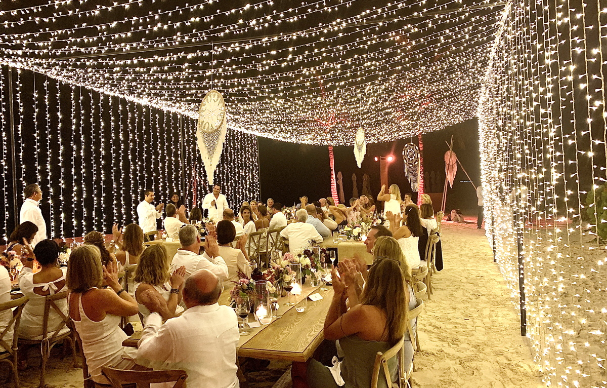 GALA TIME. Travel agents joined regional and general managers from Velas Resorts on the beach for a