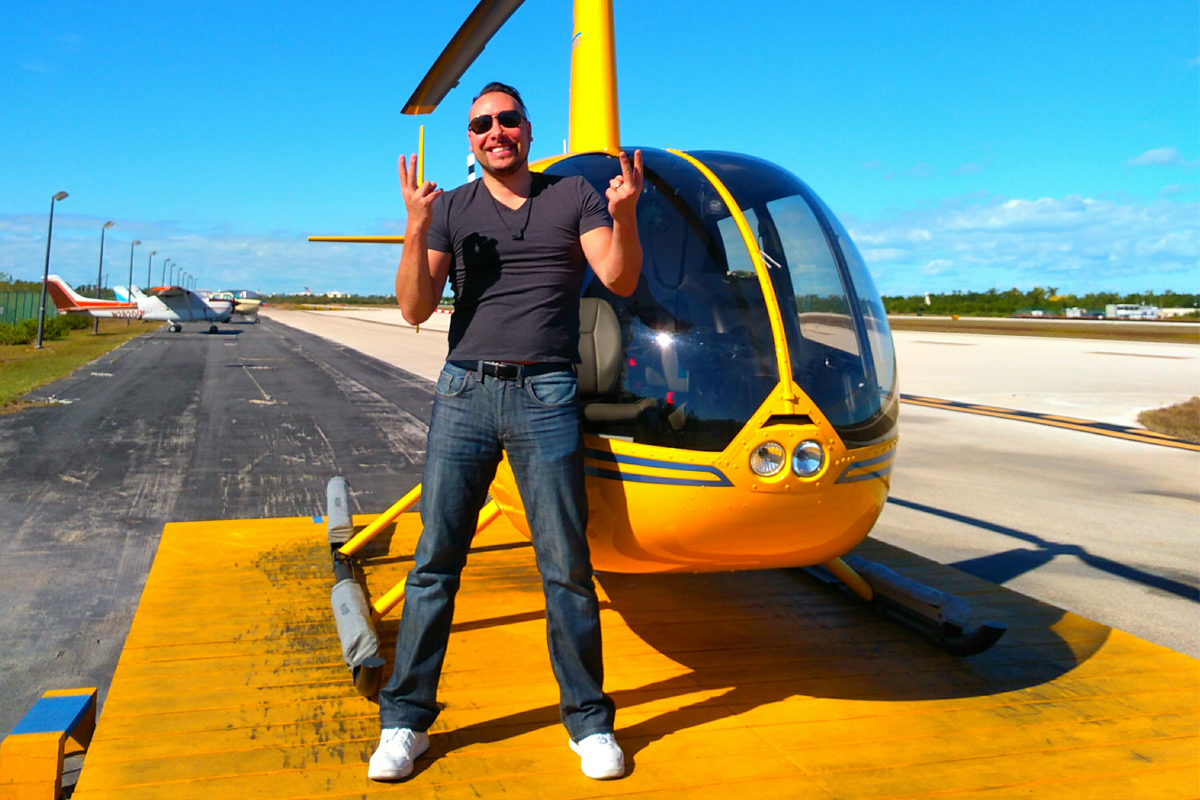 Best job ever? Jerry poses with a helicopter here in the Florida Keys. Photo courtesy of Jerry Grymek.