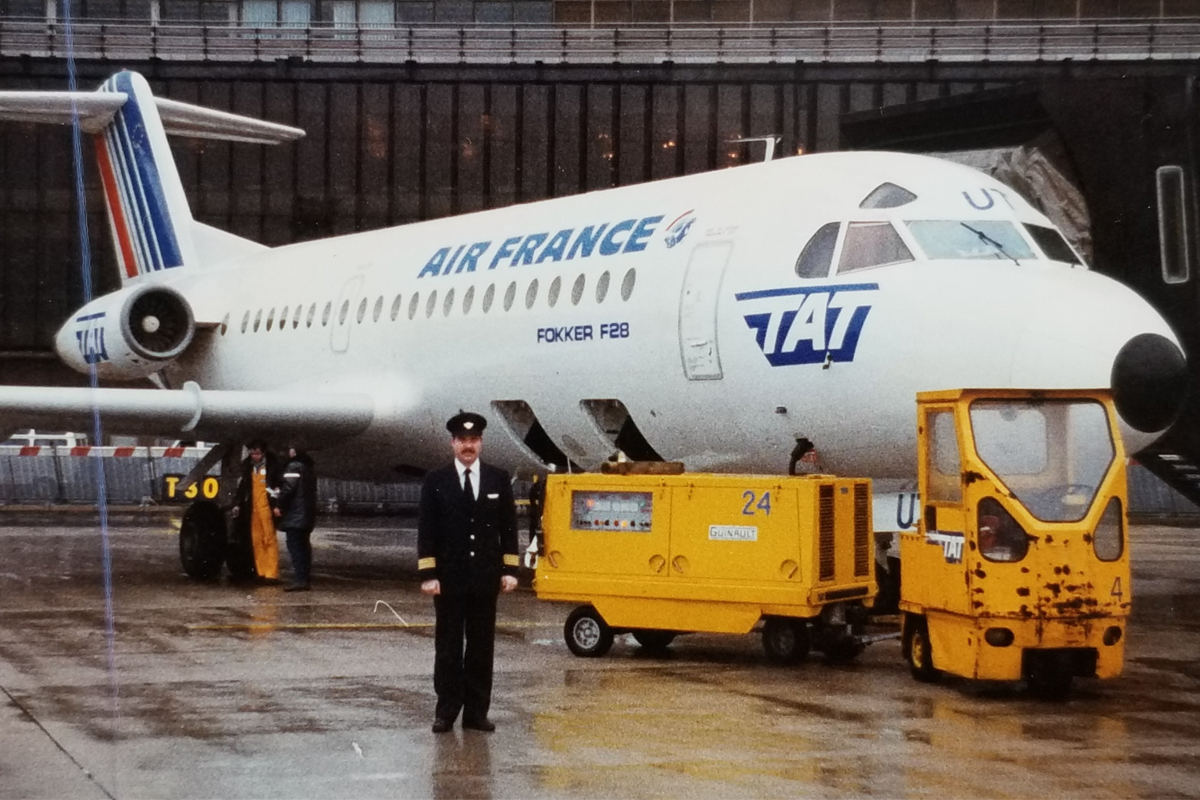 CEO of Flair Airlines, Jim Scott, poses in front of a Transport Aérien Transrégional (TAT) aircraft, which was owned and operated by Air France.