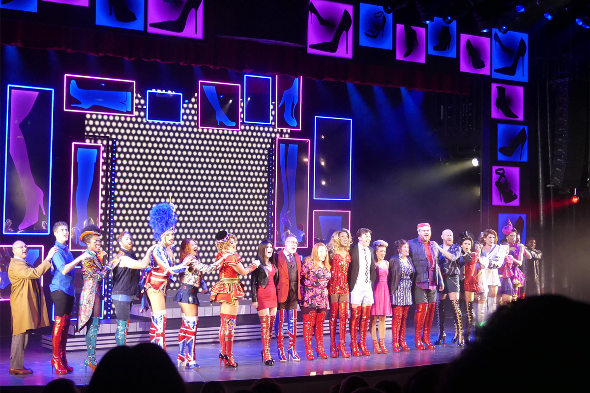 The cast of Kinky Boots receiving a standing ovation after a show-stopping performance.
