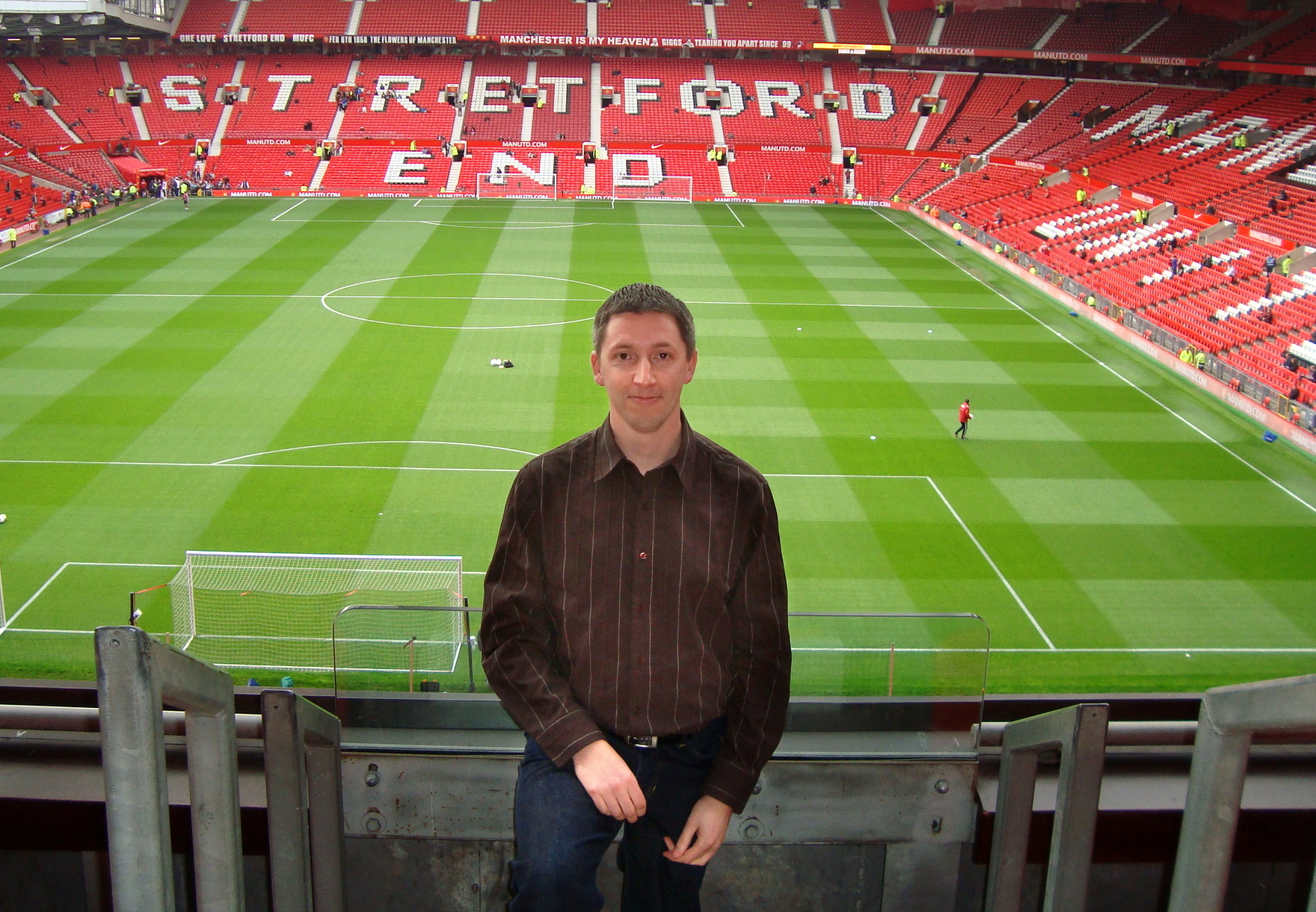 "GO TEAM. ""I have always preferred to spend on experiences, primarily sporting events,"" says Mathias, seen here at Old Trafford stadium in Manchester. (Supplied)"