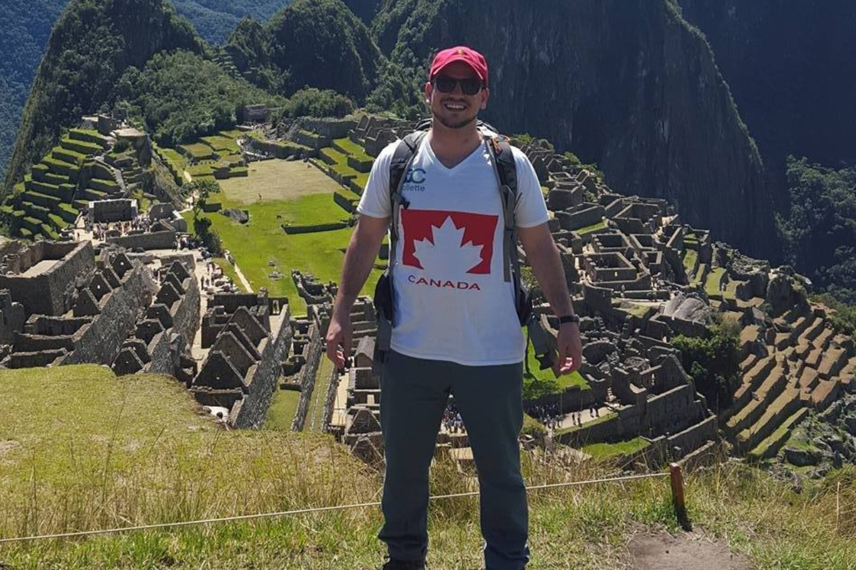 """I always make sure to have a small Canadian flag on my backpack/luggage. I am a proud Canadian when I am traveling to foreign destinations, and I want to shout it from the rooftops!"" says Nick, pictured here at Machu Picchu."