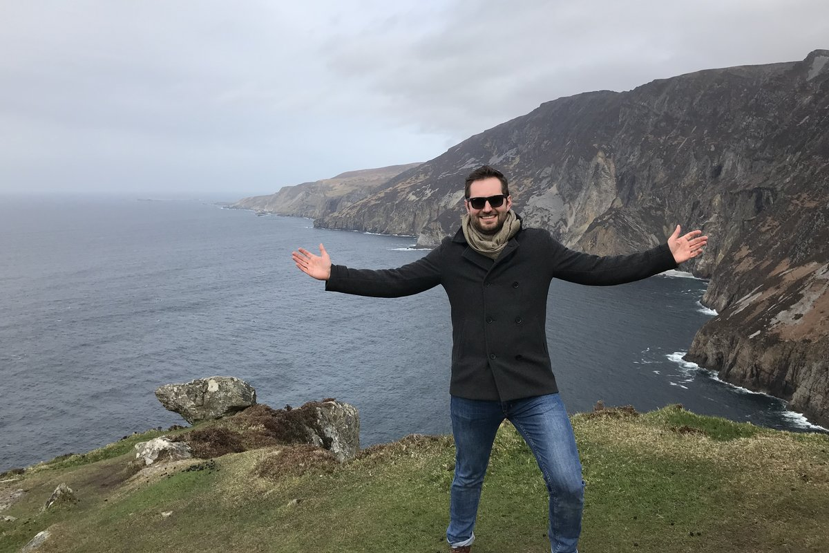Standing on the Sliabh Cliffs of Donegal, Ireland.