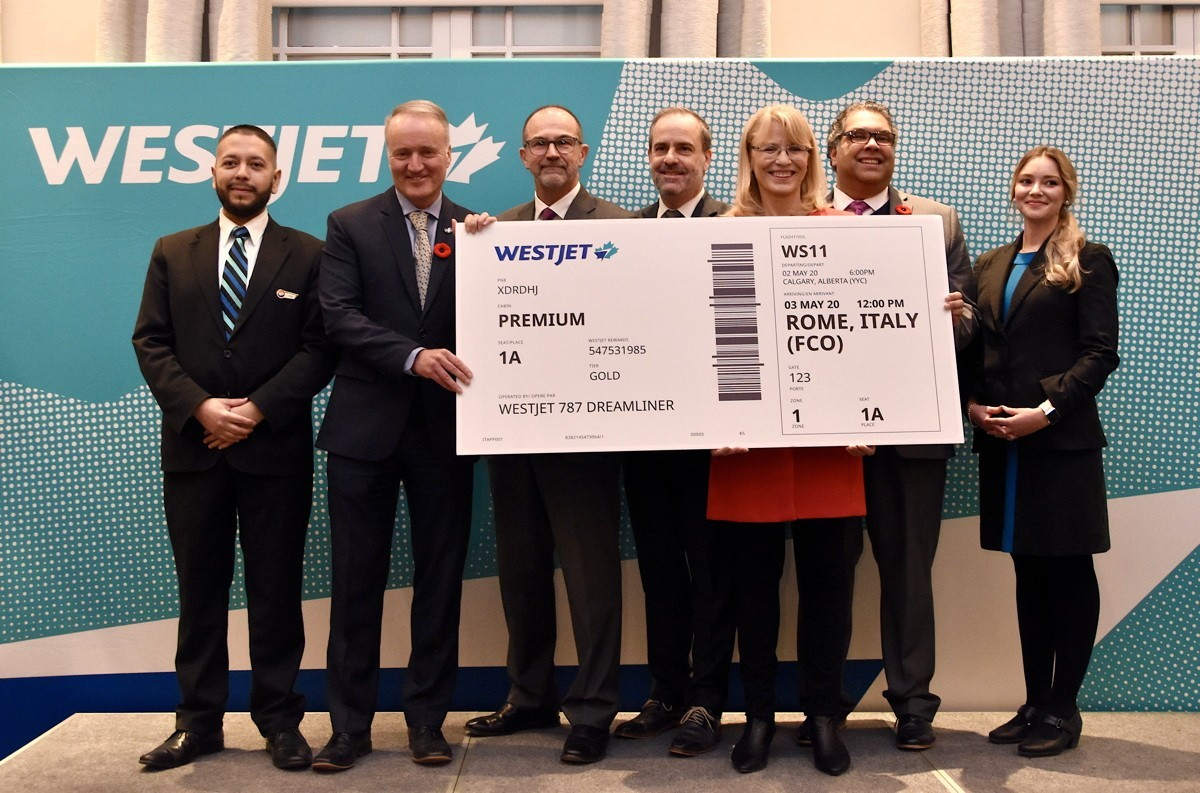 Delegates gather at the Fairmont Palliser Hotel in Calgary to unveil WestJet's new Dreamliner service from Calgary to Rome.