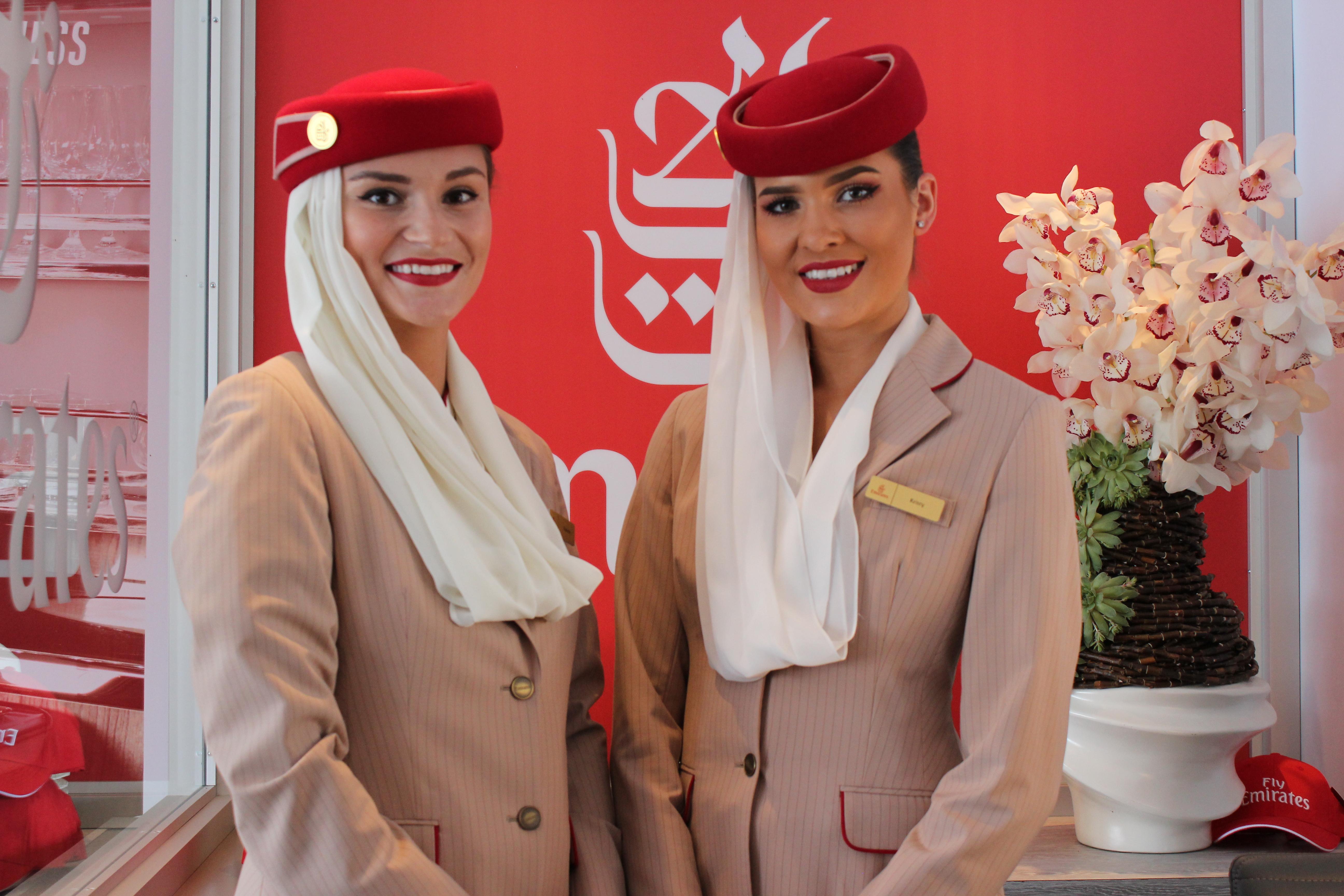 Stunning ladies showcase Emirates on board services.JPG