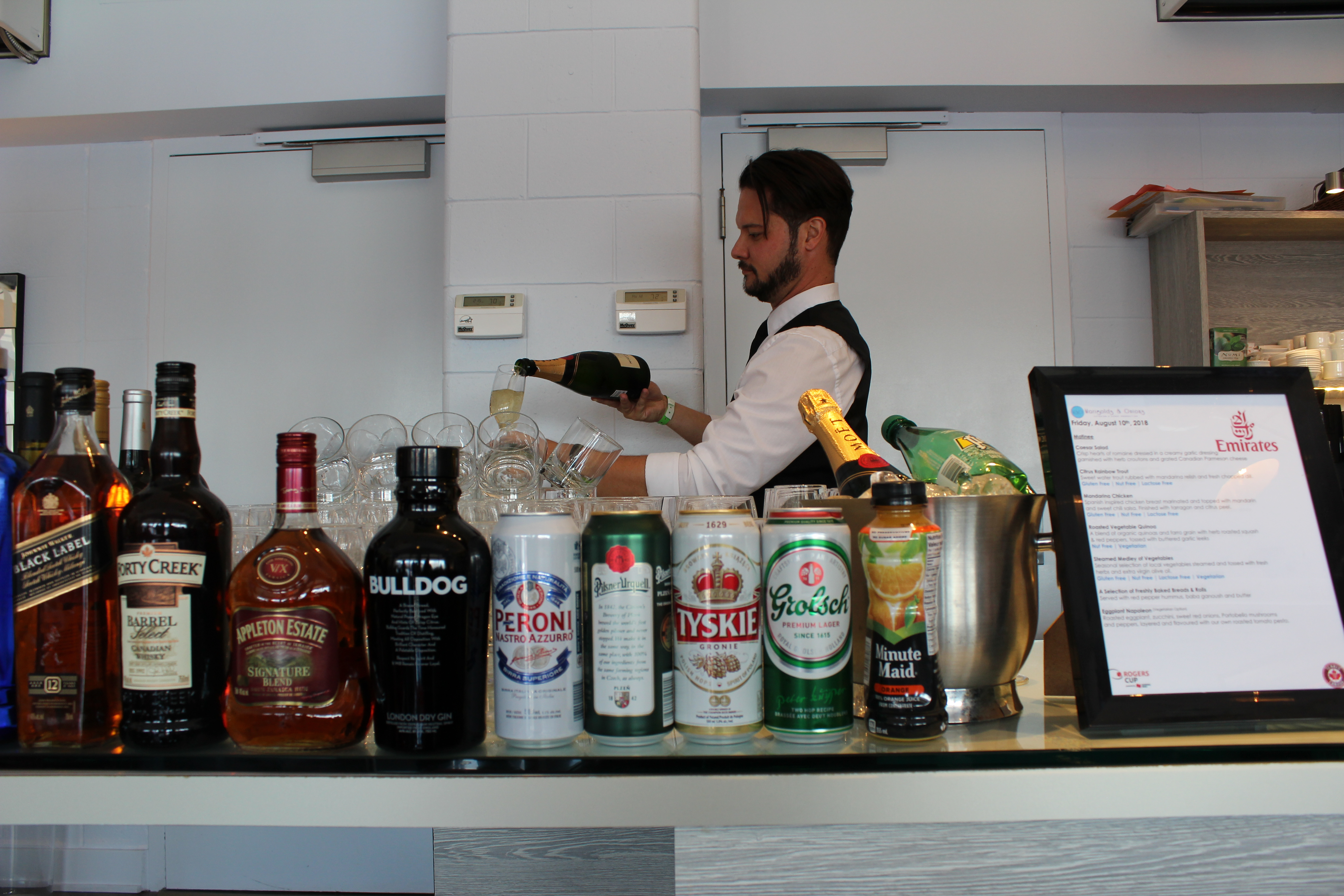 Moet is poured in the Emirates Suite.JPG