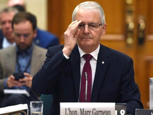 Garneau to quarantine in hotel; 500+ tickets issued; no fines reported in AB, QC